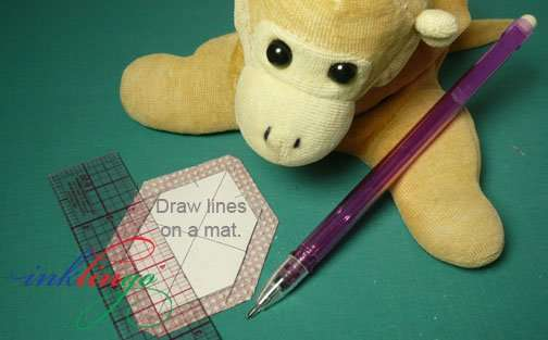 Leave the shapes on the cutting mat when you draw the lines.