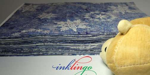 Stack of fabric printed with Inklingo